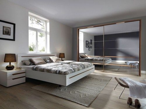 modern bedroom with floating bed Love the design But, I would add color and lots of it.
