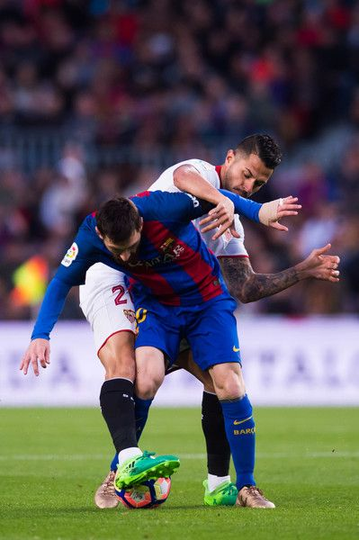Lionel Messi of FC Barcelona protects the ball from Victor Machin 'Vitolo' of Sevilla FC during the La Liga match between FC Barcelona and Sevilla FC at Camp Nou stadium on April 5, 2017 in Barcelona, Catalonia.