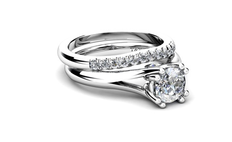 Prong set diamond solitaire engagement ring and channel set diamond wedding band, by T & T Jewellers.