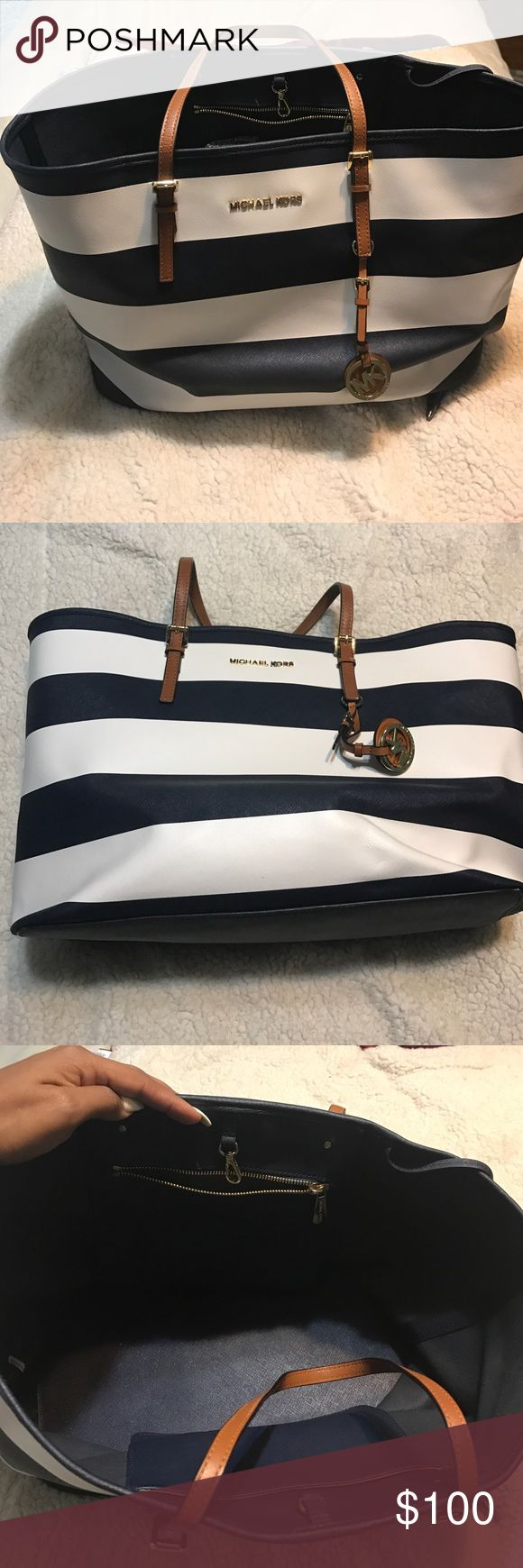 Michael Kors Nautical Blue and White Tote bag Beautiful Michael Kors Nautical Tote Bag in Navy Blue and white. Lovely for the beach, work or just a busy lady needing a cute purse to Tote around her every day essentials. negotiable so send me an offer and this beautiful bag can be yours Michael Kors Bags