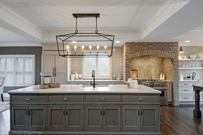 Honed quartz countertops and over-sized statement lighting complement this gourmet kitchen by Dave Fox for the 2017 NARI Home Improvement Tour.