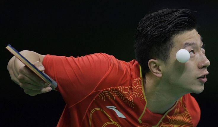 China's Ma Long serves to Britain's Liam Pitchford during the men's team…