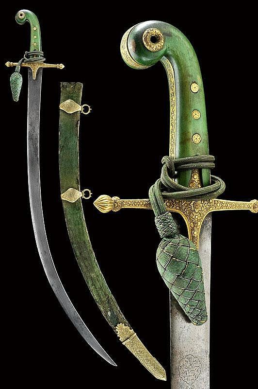 """An important shamshir. Antique, massive, curved, flat, fine damask, single-edged blade, a cartouche with inscription in Arabic & remains of gilding on a side, gold-inlaid stamps """"ARCOTE NOV. 4 1845"""" in a cartouche & """"CIVILIAN"""" under a horse; gilt-brass hilt, richly engraved with floral motifs, green, ivory grip scales, complete with sword knot in the shape of a green-&-gold cone.    dating: circa 1800;  dimensions: 88 cm.;  provenance: Persia"""