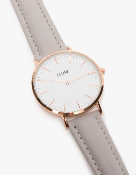 From Cluse, a sleek and minimalist watch with a genuine leather wrist band in grey. Features an easy clip on, clip off band pins, rose gold clasp and rose gold and white face details.   •Minimalist watch •Stainless Steel back •Rose gold hardware •