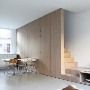 8A Architecten adds combined staircase  and sofa to Leiden house