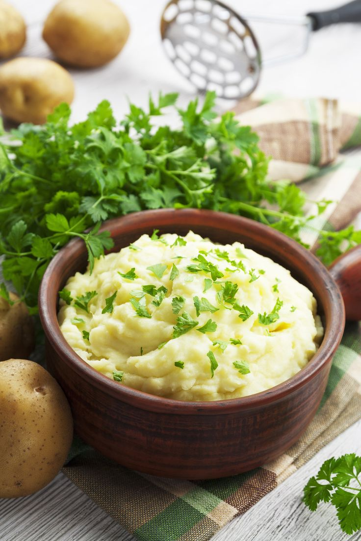 Try adding a pinch of baking powder to the potatoes before you mash them. It will help make the mashed potatoes much lighter and fluffier.