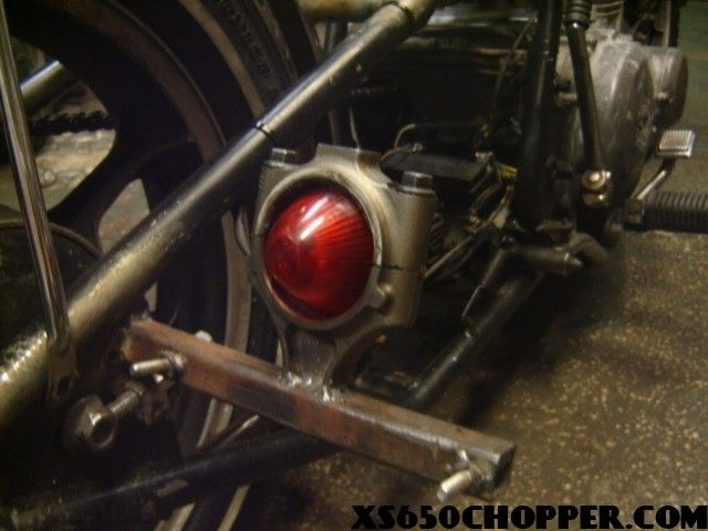 Thought everyone would get a kick out od these tail lights, the one is a flash light from the fifties, the other one is an old ford piston arm. Frank…