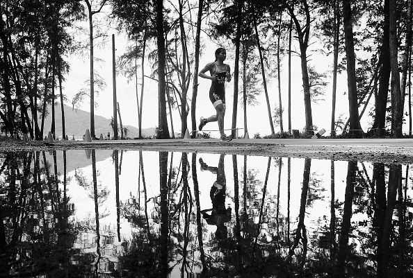 NOVEMBER 17: EDITORS NOTE: Image has been converted to black and white.) Zhiyun Ethel Lin of Singapore runs during the Women's triathlon at the 2014 Asian Beach Games at Nai Yang Beach on November 17, 2014 in Phuket, Thailand. (Photo by Quinn Rooney/Getty Images)
