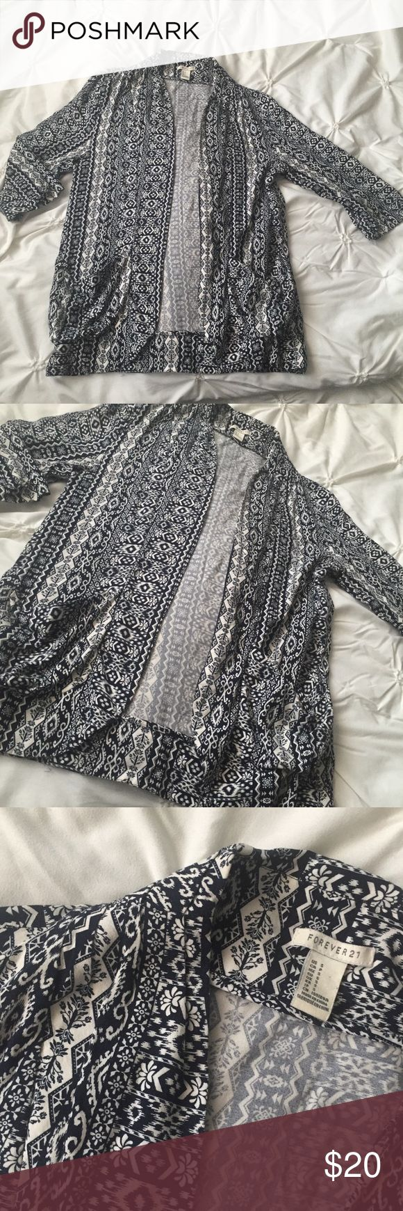 Forever 21 Navy Tribal Aztec Short Sleeve Cardigan Forever 21 Navy Tribal Aztec Short Sleeve Cardigan Top size Small ------ 🚭 All items are from a non-smoking home. 👆🏻Item is as described, feel free to ask questions. 📦 I am a fast shipper with excellent ratings. 👗I love bundles & bundle discounts. Feel free to make an offer! 😍 Like this item? Check out the rest of my closet! 💖 Thanks for looking! Forever 21 Tops