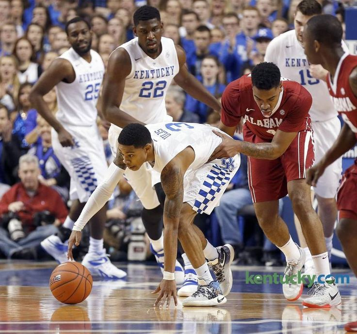 Alabama Crimson Tide guard Arthur Edwards (4) fouled Kentucky Wildcats guard Tyler Ulis (3) from behind as the University of Kentucky played the University of Alabama in Rupp Arena in Lexington, Ky., Tuesday, February 23 2016. This is first half mens basketball action.