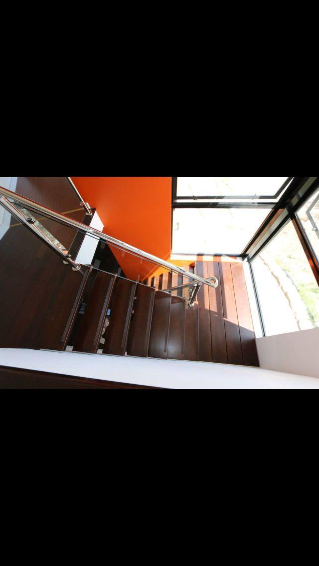 Steel stringers, stained tasmanian oak open tread staircase. Stainless steel wire balustrade with Jarrah Handrail