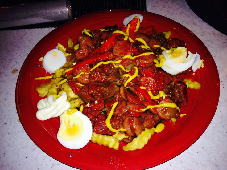 Pique macho!! beef, potato fries, sausages, tabaco Sauce, onion. Eggs And woala!!! So yummy