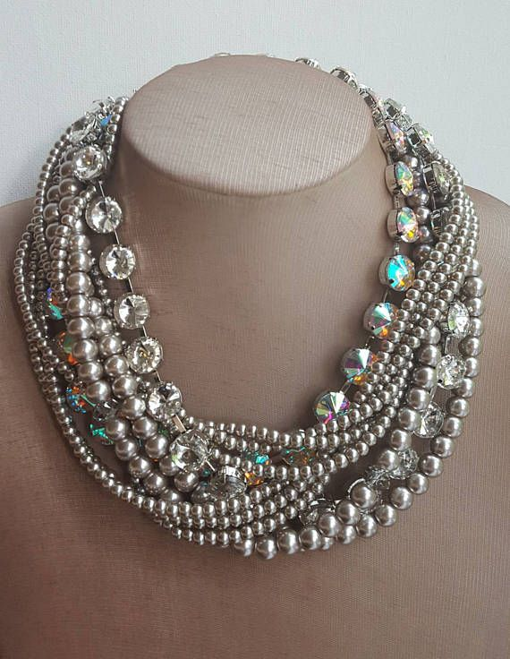 Check out this item in my Etsy shop https://www.etsy.com/ca/listing/537171769/multistrand-pearl-and-crystal-boho