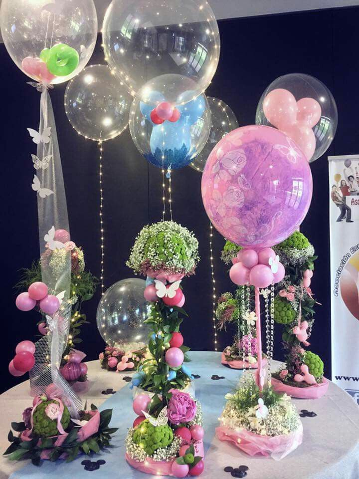 Wow! These are gorgeous balloon centerpieces. Love the combination with decorative plants, butterflies and tulle.