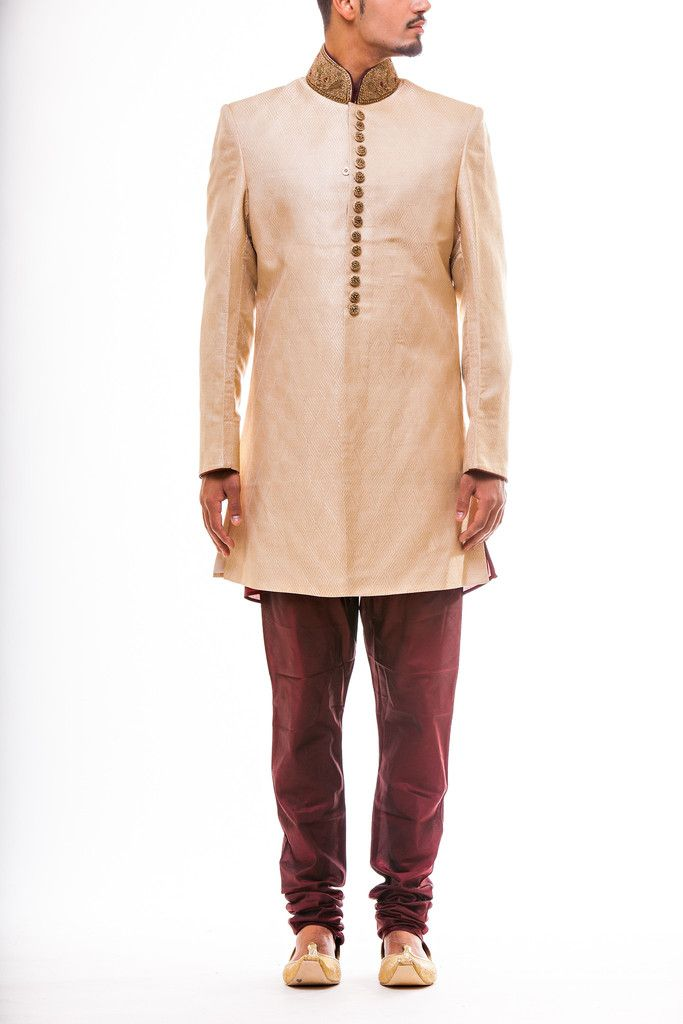 Gold Sherwani in self on self Brocade with zardozi work collar and Buttons paired with Maroon Churidaar