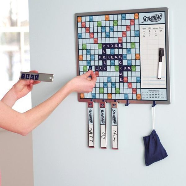 Ongoing magnetic scrabble game to hang by door.