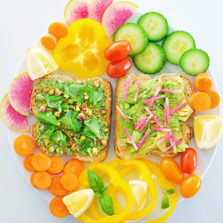 Colorful lunch platter with sourdough bread and veggies