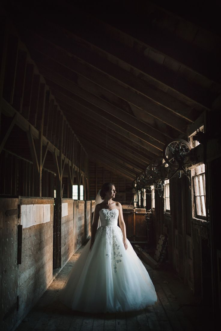 Bridal portraits in the woolshed. Love, love, LOVE the light in this photo!