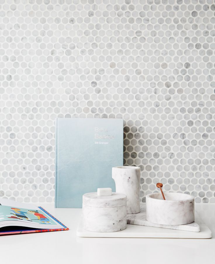 Kitchen: marble penny-round mosaic tile splashback, small marble circular round storage boxes