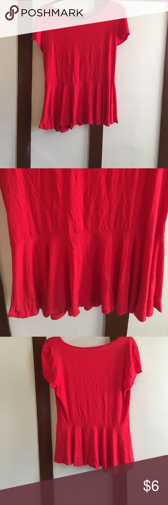 Relaxed peplum top Red short sleeve top with a relaxed peplum style. Loose soft style made of rayon and spandex. Never worn but does not have tags. Forever 21 Tops Tees - Short Sleeve