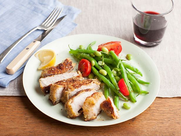 http://www.foodnetwork.com/recipes/giada-de-laurentiis/parmesan-crusted-pork-chops-recipe.html2 large eggs 1 cup dried Italian-style bread crumbs 3/4 cups freshly grated Parmesan 4 (1/2 to 3/4-inch thick) center-cut pork loin chops (each about 10 to 12 ounces) Salt and freshly ground black pepper 6 tablespoons olive oil Lemon wedges, for serving