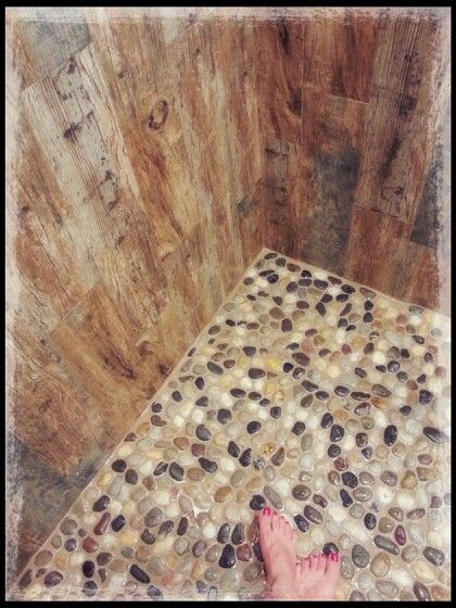 Our shower using faux wood tiles..