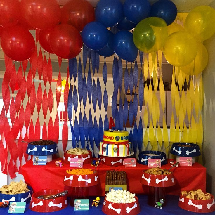 Paw patrol Birthday party with dog bowls and dog themed food.