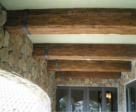 Faux wood beams are the perfect touch for this stone for Fake wood beams for ceiling