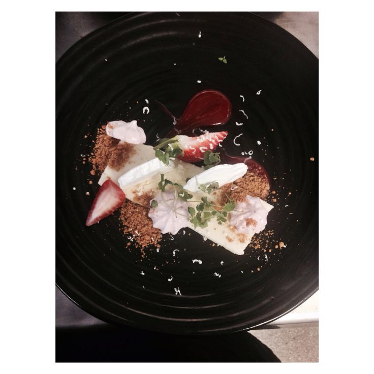 White chocolate cheesecake, compressed and fresh strawberries. Strawberry meringue and cheesecake crumb