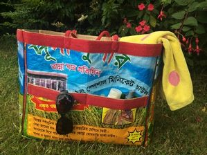 BIBHA - Recycled Rice Bag - All purpose Bag/Tote. These Bags are multi tasking. Light & roomy with two outside pockets each side they are perfect for the beach, picnics, files & paper work or use as a great garden bag. Dimensions: H 36cm/width 46cm/gusset 20cm/handle 45cm