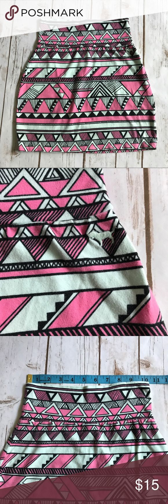 VS PINK Aztec Tribal Print Skirt Super stretchy and comfortable gently loved skirt. Measurements in pictures. 95% cotton; 5% elastane. Machine wash cold. Fuzz balls all over skirt. PINK Victoria's Secret Skirts Mini