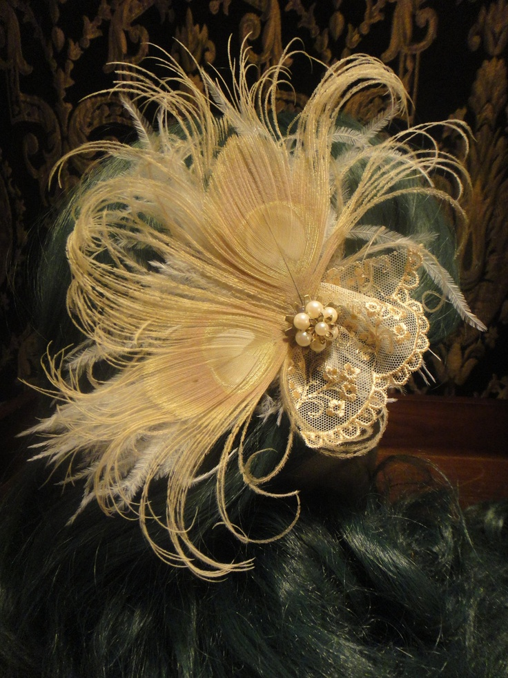 Steampunk Butterfly Feather Bridal Hair Fascinator Kanzashi Clip With  Ivory Peacock Ostrich Lace Veil and Vintage Pearl Button. $35.00, via Etsy.
