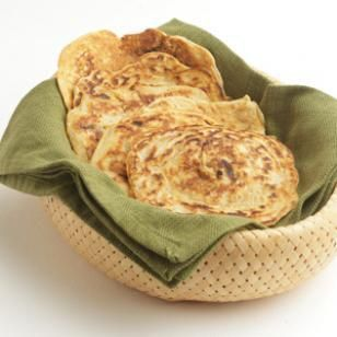 Caramelized Onion Flatbreads Recipe -- delicious with a saucy curry