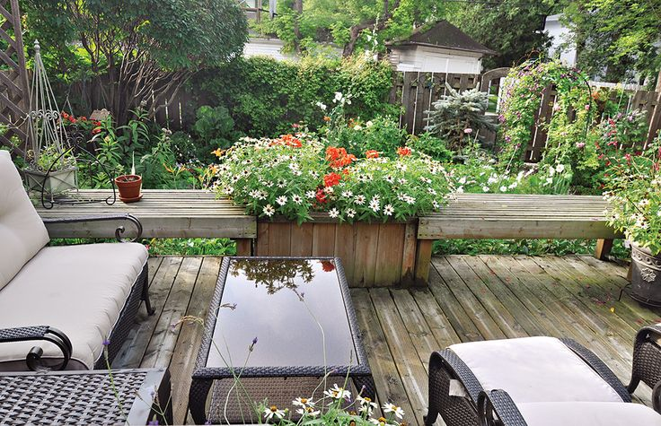 The cosy back deck is a wonderful place to take in the garden's beauty.