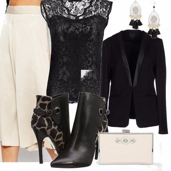 Questa sera per partecipare ad un evento in un locale alla moda della mia città, opto per un look sobrio ed elegante, con gonna pantalone in rasatello e top in pizzo nero. Accessori di classe abbinati.