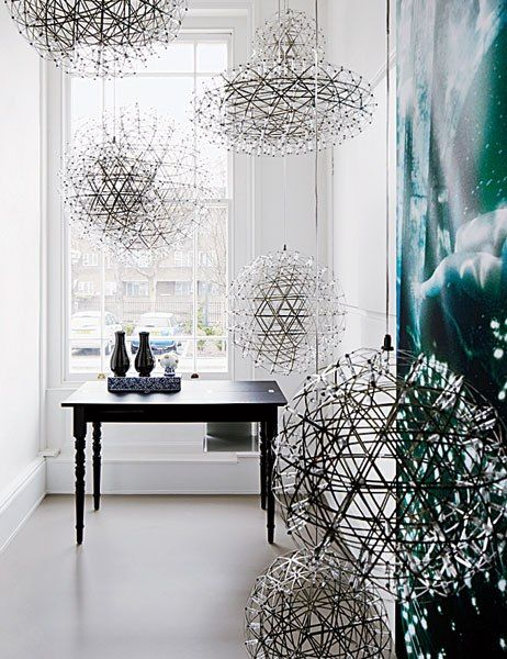Dutch design collective Moooi highlights its Raimond LED pendant lamps.