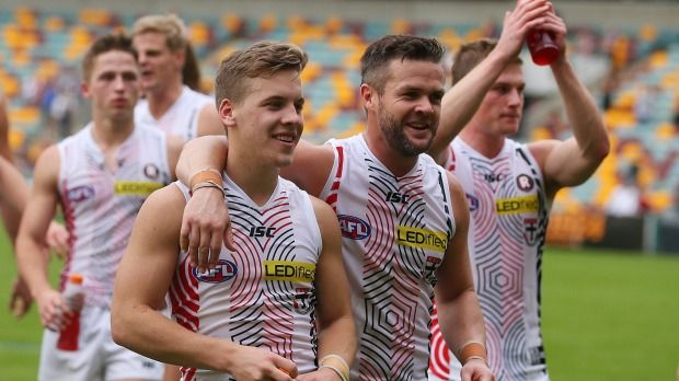Jack Lonie with his mate Adam Schneider after defeating the Brisbane Lions in round nine.