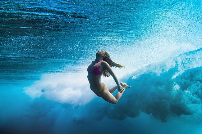 Beautiful Pictures of Female Surfers as They Plunge Beneath the Ocean Waves » Design You Trust – Design Blog and Community