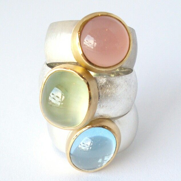 New silver rings with 22 karat gold. The gemstones are a light blue topaz, a prehnite and a pink chalcedony. You can buy them in our webshop: www.heleenhoogenboom.com