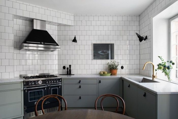 Classic Scandi Apartment with Industrial Windows and subway tile walls