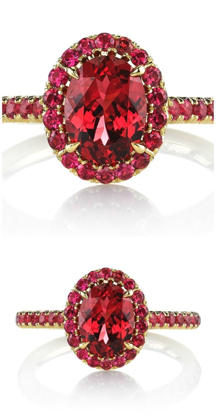 The Omi Prive Dore'ring featuring a 1.48 carat oval red spinel surrounded by 0.56 carats of round red spinels in 18k yellow gold.
