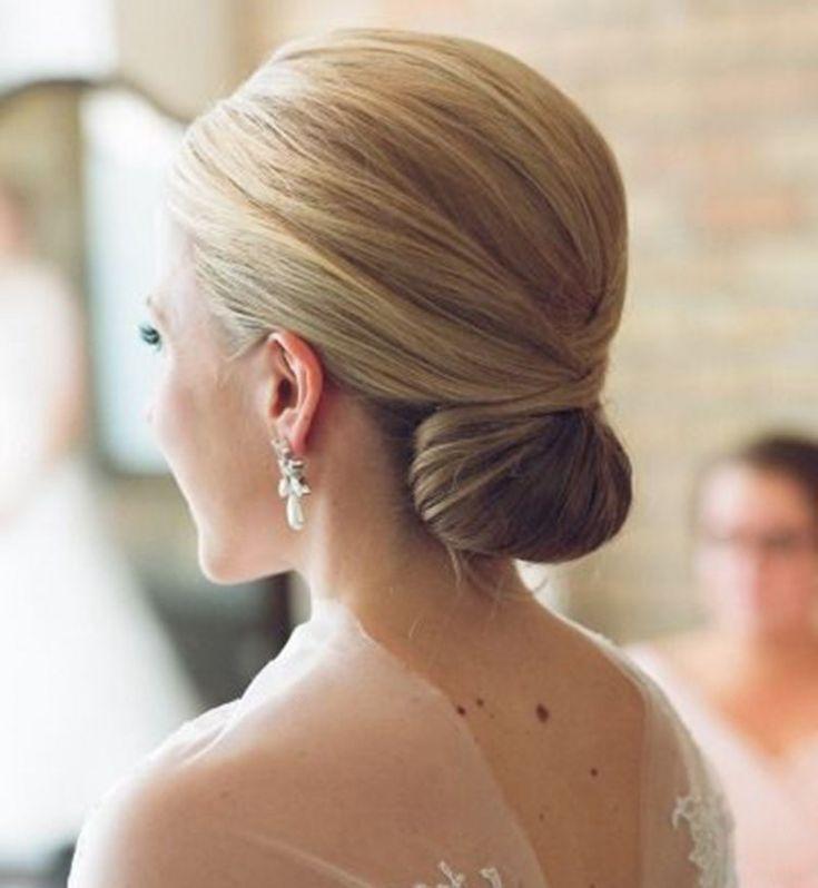 Idée coiffure de mariage  un chignon bas classique de mariage