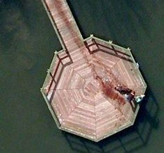 A murder scene caught on Google maps, 2 men throwing body in water in an image form 2009 in Google Maps