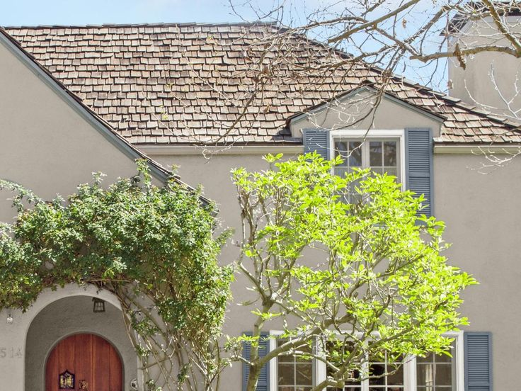 The roof is topped with cedar shakes. Not only can they last upward of 30 years, but they also resist wind damage and have a textured look that adds to the house's rustic appeal.