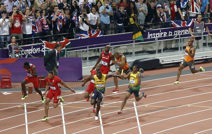 Jamaica's Usain Bolt takes the baton to lead in the men's 4 x 100-meter relay during the athletics in the Olympic Stadium at the 2012 Summer Olympics, London, Saturday, Aug. 11, 2012.