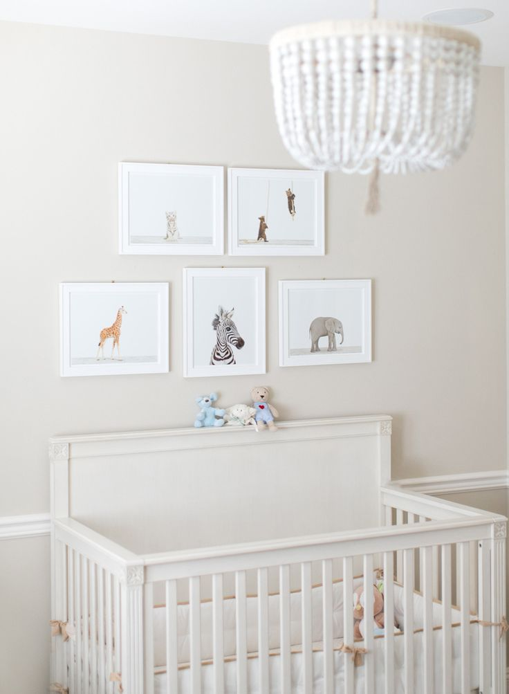 Fresh white nursery featuring our Malibu Chandelier and Mocha Nursery Basics Crib Bumper. #serenaandlily
