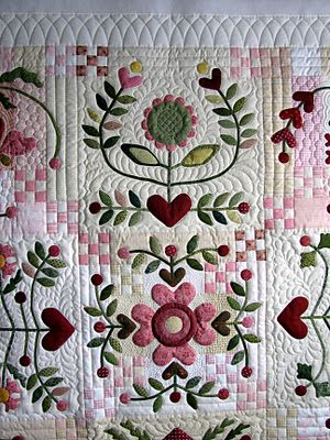 Applique with interesting 9-patches heart/flower quilt