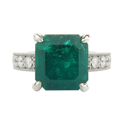 EMERALD & DIAMOND RING  A custom designed Emerald and Diamond ring set in white gold.