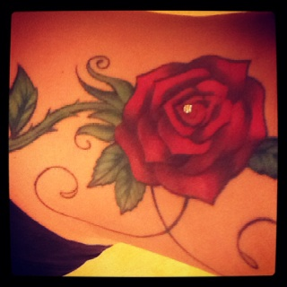 My rose tattoo with dermal - My daughter designed this too!  Her art 100%