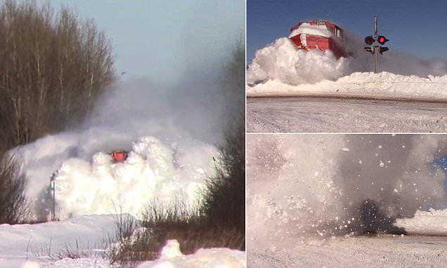 Canada train ploughs through thick snow